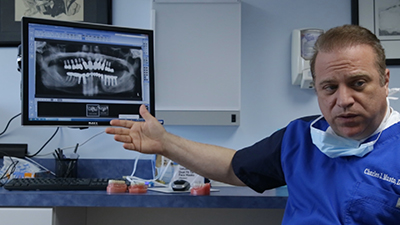 Dr. Musto explaining x-ray results at Dr. Musto Periodontics & Dental Implants office