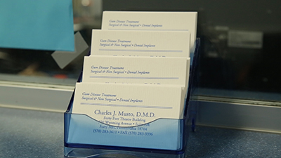 Dr. Musto's business Cards at Dr. Musto Periodontics & Dental Implants