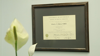 Doctor Musto's University Degree displayed at Dr. Musto Periodontics & Dental Implants office